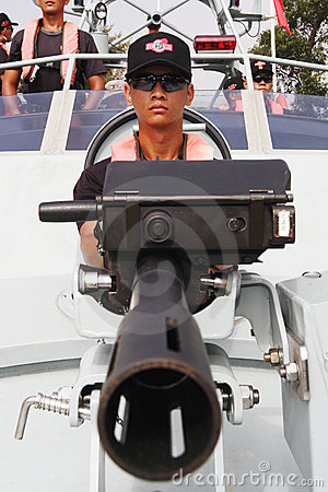 Soldier in the speed boat Editorial Photography