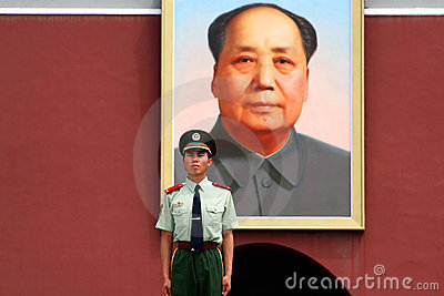 Soldier stands guard in front of Mao Editorial Image