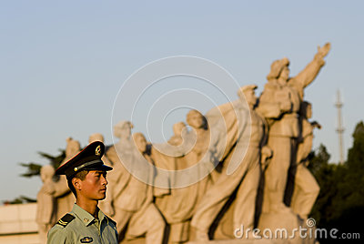 A soldier under the revolutionary sculpture, beijing, china Editorial Image