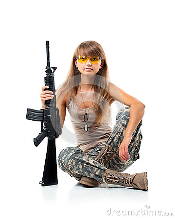 Soldier young beautyful girl dressed in a camouflage with a gun