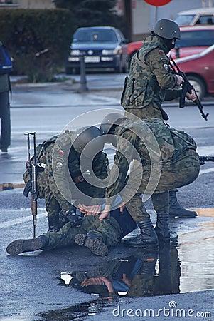 Soldiers arresting a criminal