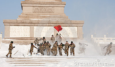 Soldiers enjoy snow in Tiananmen Square Editorial Stock Image