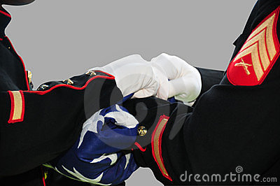 Soldiers folding American flag