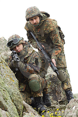 Soldiers in heavy combat ammunition