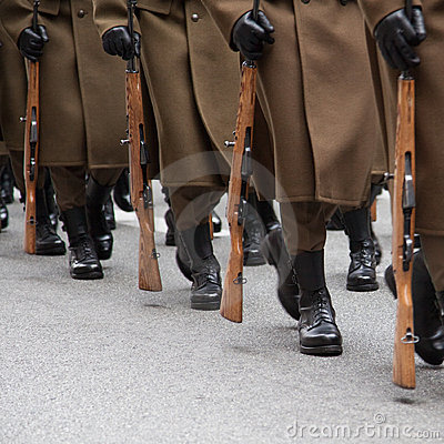 Soldiers marching in a row