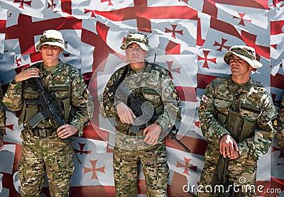 Soldiers posing. Georgian flag. Tbilisi. Georgia. Editorial Stock Image