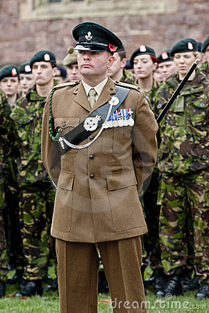 Soldiers stand to atention a the rememberance Day Editorial Photo