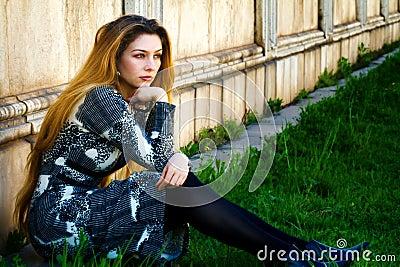 Solitude - sad pensive woman sitting alone