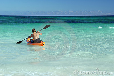 Solo canoeist paddling in sea