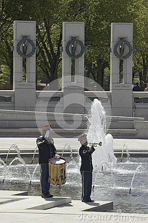 Solo trumpeter and drummer performing taps Editorial Photo