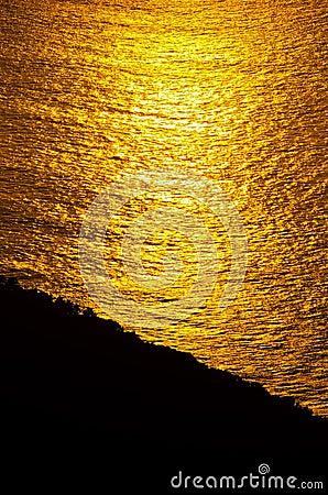 Soluppgångglöd av hav