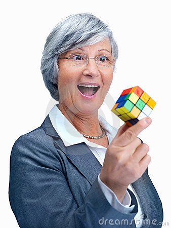 Solution - exited business woman holding a  cube Editorial Stock Photo