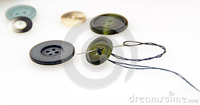 Some buttons and needle