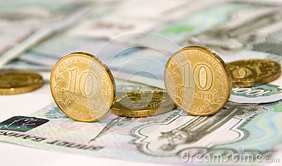 Some coins on banknotes