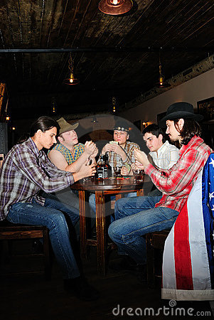 Some cowboys play cards