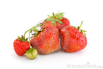 Some ripe red and one unripe strawberries
