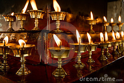 Some rows of candles in Tibetan temple