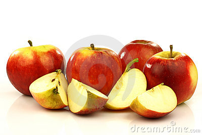 Some whole and some cut red and yellow apples