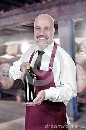 Sommelier Waiter with bottle of red wine
