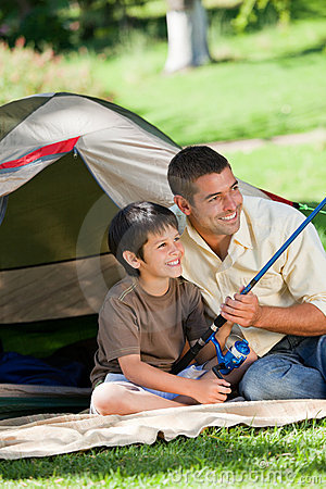 Son fishing with his father