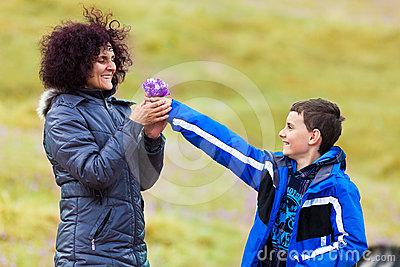 Son giving flowers to his mother