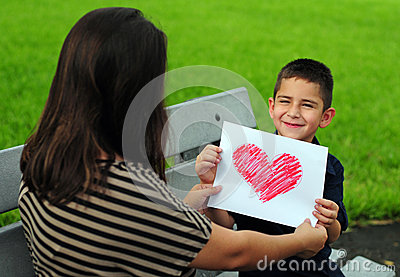 Son giving mom heart drawing