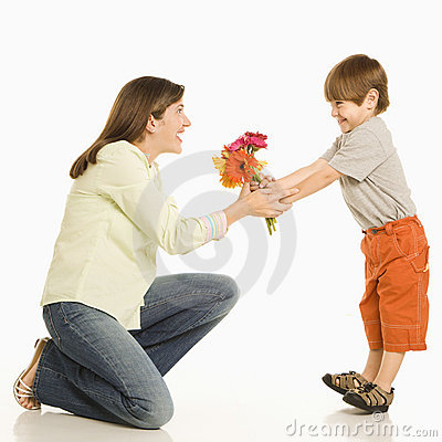 Free Son Giving Mother Flowers. Royalty Free Stock Photos - 2771608