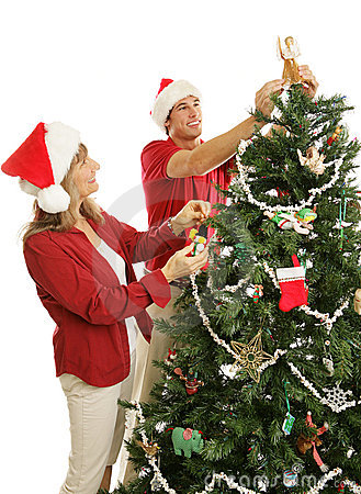 Son Helps Mom Decorate Christmas Tree