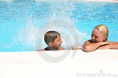 Son and mom  in the pool