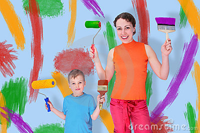 Son and mother draw with rollers and brushes