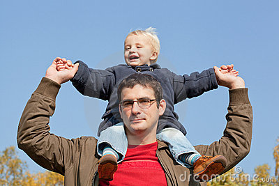 son sits on shoulders at the father