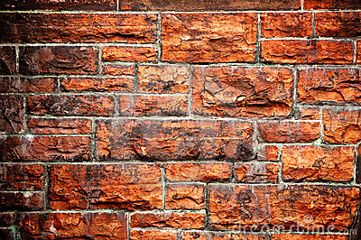 Soot stained red brick wall