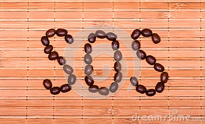 SOS from coffee beans on a decorative straw