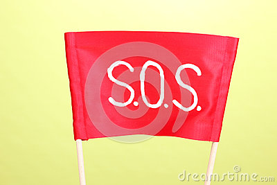 SOS signal written on red cloth