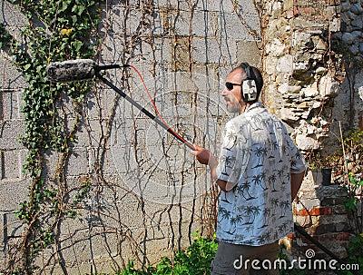 Sound Engineer with Shotgun Microphone