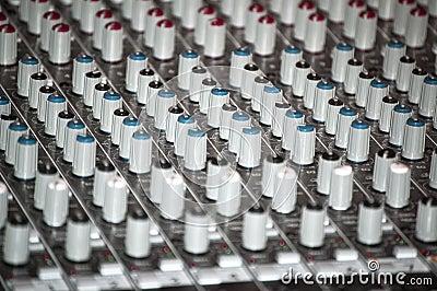 Sound mixer console in a recording studio
