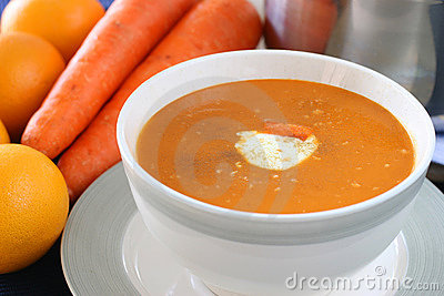 Carrot and orange soup with a dollop of creamy yogurt and sprinkle of ...
