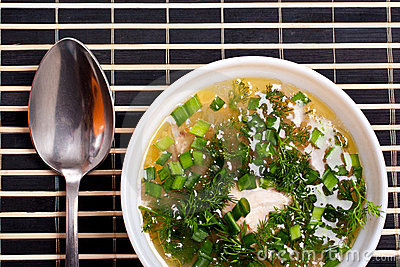 Soup with greenery