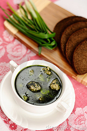 Soup with spinach and meatballs