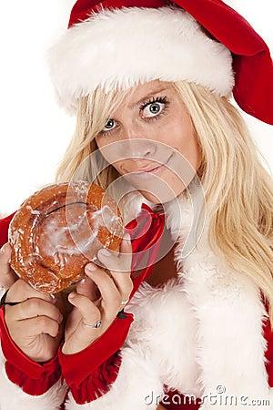 Sourire affecté de beignet de Mme Santa