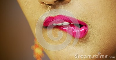 South Asian Woman lips mouth biting lip colorful pink Stock Photo