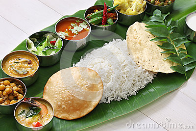 South indian meals served on banana leaf royalty free for Aharam traditional cuisine of tamil nadu
