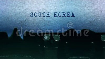 SOUTH KOREA words Typing on a sheet of paper with an old vintage typewriter. stock footage