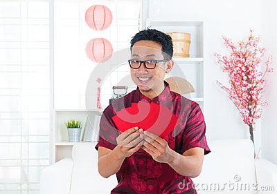 Southeast Asian Chinese man indoors