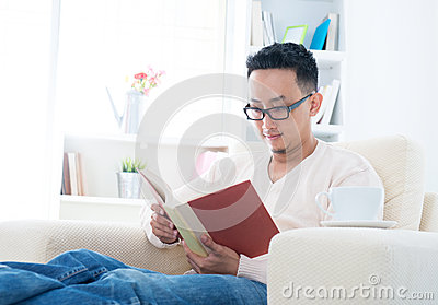 Southeast Asian male reading book