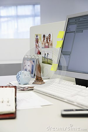 Souvenirs And Computer On Office Desk