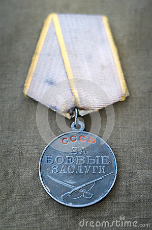 Free Soviet Medal For Combat Service And Two Red Carnations. Royalty Free Stock Photography - 52992587