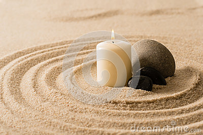 Spa atmosphere candle zen stones in sand