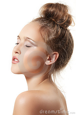 Spa beauty model with clean skin and bun hairstyle