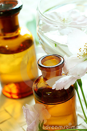 Spa composition of bottles and flowers